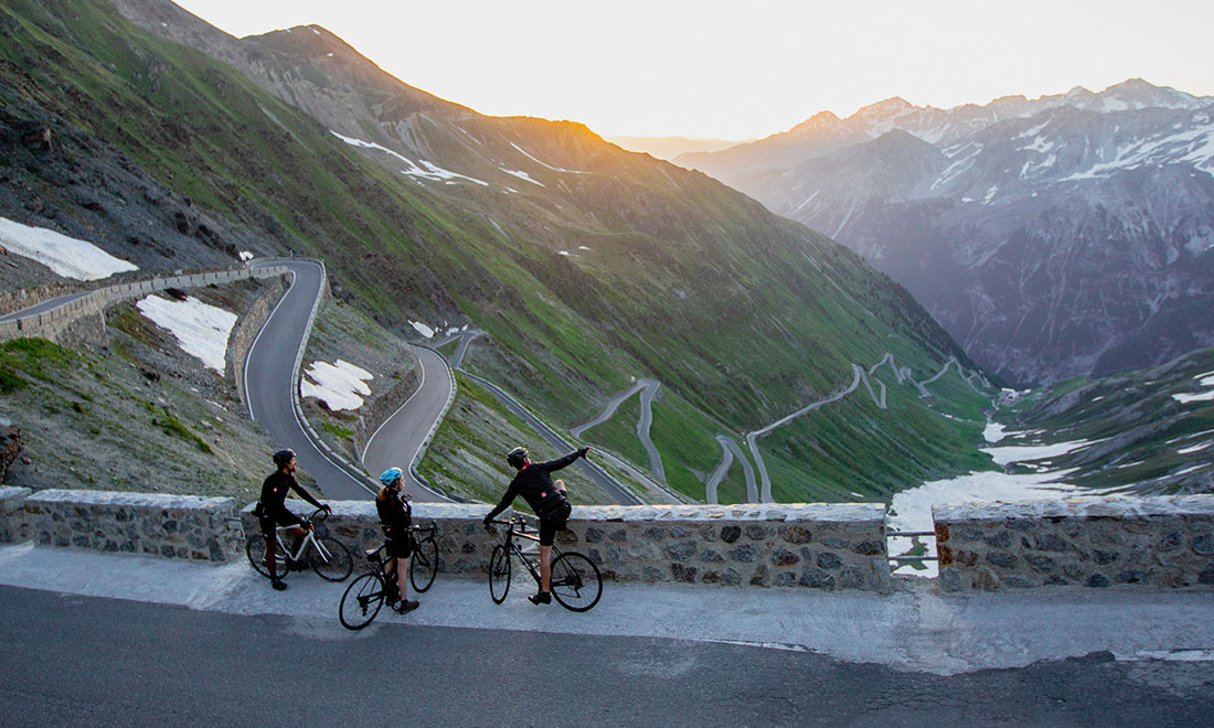 Cyclists and guides on Stelvio Pass